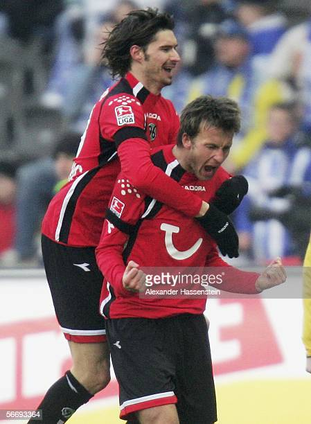 Christoph Dabrowski of Hanover celebrates after scoring the fisrt goal with Thomas Brdaric of Hanover during the Bundesliga match between Hertha BSC...