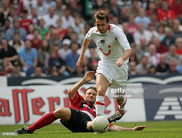 Christoph Dabrowski of Hanover is challenged by Jens Nowotny of Leverkusen during the Bundesliga match between Hanover 96 and Bayer Leverkusen at the...