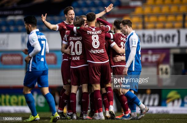 Christoph Daferner of Dresden celebrates with team mates after scoring his teams first goal during the 3. Liga match between SV Meppen and Dynamo...