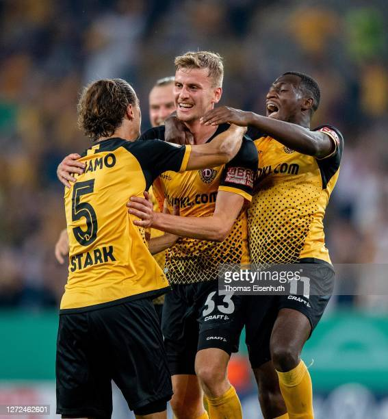 Christoph Daferner of Dynamo Dresden celebrates after scoring his team's third goal with Agyemang Diawusie , Yannick Stark and Sebastian Mai during...
