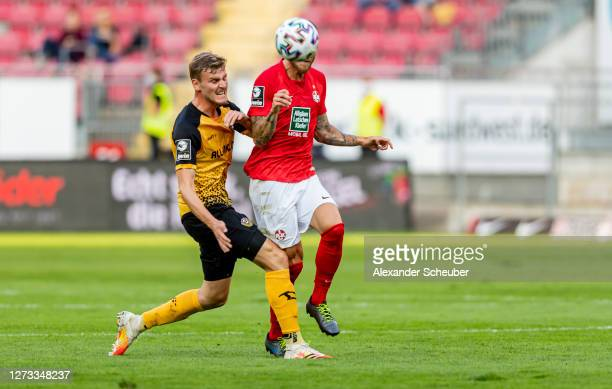 Christoph Daferner of Dynamo Dresden in action against Tim Rieder of Kaiserslautern during the 3. Liga match between 1. FC Kaiserslautern and Dynamo...
