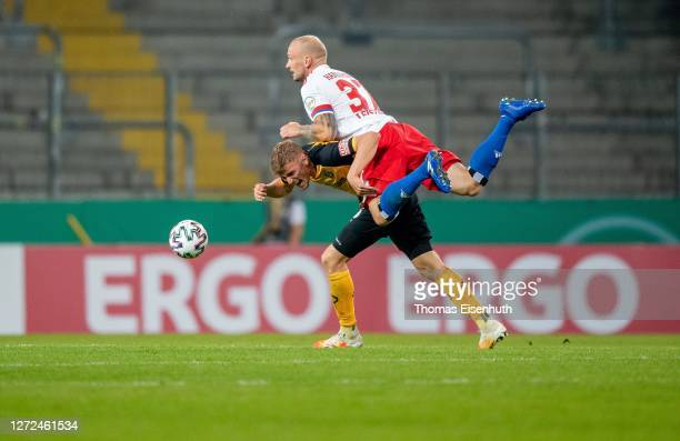 Christoph Daferner of Dynamo Dresden is challenged by Toni Leistner of Hamburger SV during the DFB Cup first round match between Dynamo Dresden and...
