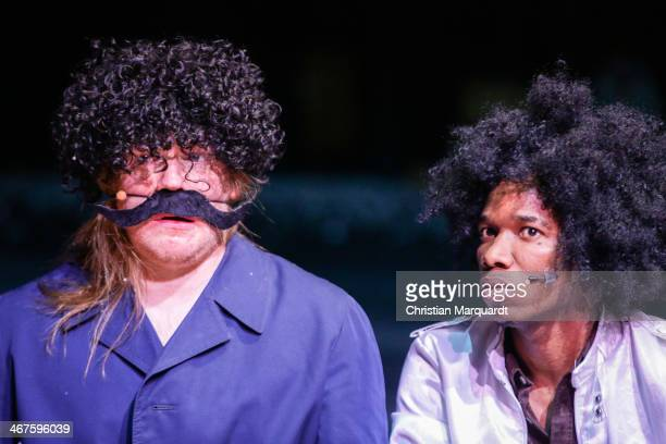 Christoph Franken and Ibrahima Balde perform on stage during rehearsals for 'Tee Im Harem Des Archimedes' at Deutsches Theater Berlin on February 07,...