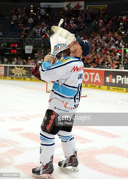 Christoph Gawlik holds the trophy after game seven of the DEL playoff final on April 29, 2014 in Cologne, Germany.