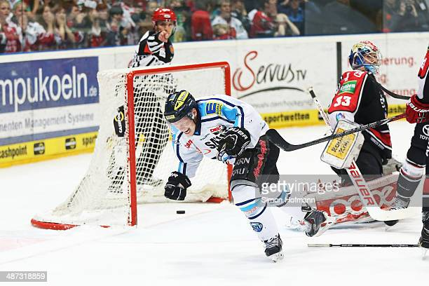 Christoph Gawlik of Ingolstadt celebrates his team's first goal during game seven of the DEL final play-offs between Koelner Haie and ERC Ingolstadt...