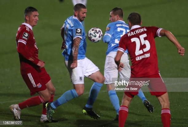 Christoph Greger and Paul Grauschopf of SpVgg Unterhaching battle Sascha Moelders and Richard Neudecker of TSV 1860 Muenchen during the 3. Liga match...