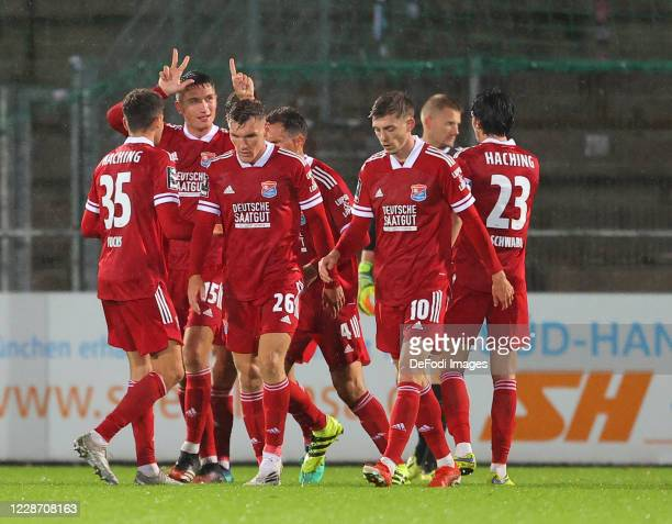 Christoph Greger of SpVgg Unterhaching celebrates after scoring his team's first goal with team mates during the 3. Liga match between SpVgg...