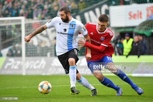 Christoph Greger of Unterhaching and Sascha Moeldersof TSV 1860 Muenchen compete for the ball during the 3. Liga match between SpVgg Unterhaching...