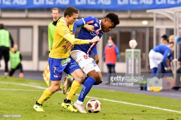 Christoph Gschiel of Lafnitz and Nosa Iyobosa Edokpolor of FC Linz during the 2 Liga match between FC Blau Weiss Linz v SV Lafnitz at Stadion der...