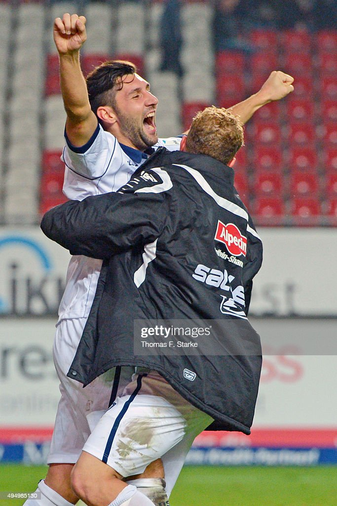 Christoph Hemlein (R) and Stephan Salger of Bielefeld celebrate their teams second goal during the Second Bundesliga match between 1. FC Kaiserslautern and Arminia Bielefeld at Fritz-Walter-Stadion on October 30, 2015 in Kaiserslautern, Germany.