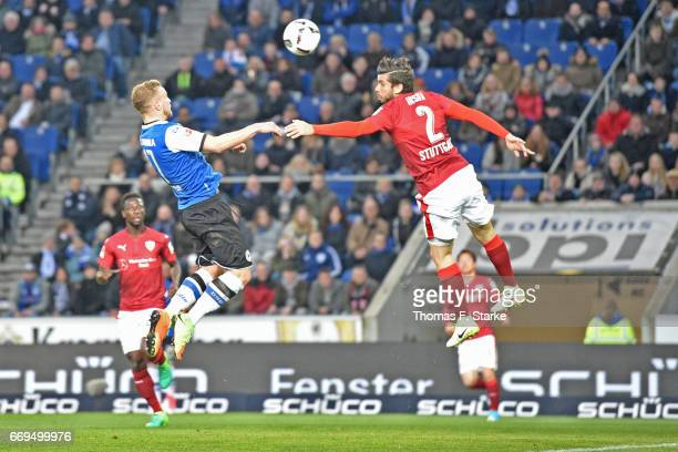 Christoph Hemlein of Bielefeld heads his teams first goal during the Second Bundesliga match between DSC Arminia Bielefeld and VfB Stuttgart at...