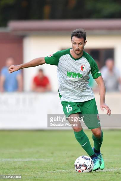 Christoph Janker of Augsburg plays the ball during the pre-season friendly match between SC Olching and FC Augsburg on July 19, 2018 in Olching,...