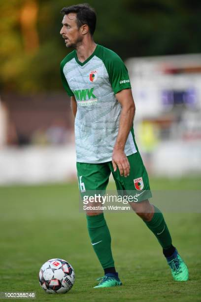 Christoph Janker of Augsburg plays the ball during the preseason friendly match between SC Olching and FC Augsburg on July 19 2018 in Olching Germany