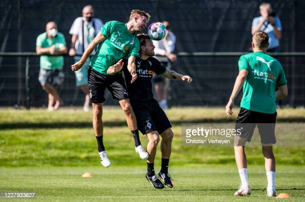 Christoph Kramer and Assistant Coach Eugen Polanski of Borussia Moenchengladbach battle for the ball during a training session of Borussia...