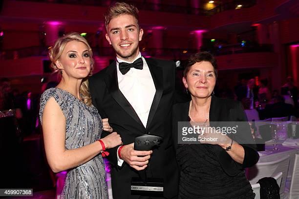 Christoph Kramer and his girlfriend Celina Scheufele and his mother Gabi during the Audi Generation Award 2014 at Hotel Bayerischer Hof on December...