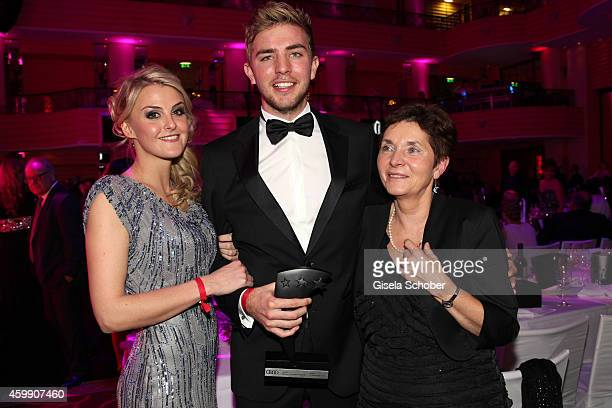 Christoph Kramer and his girlfriend Celina Scheufele and his mother Gabi during the Audi Generation Award 2014 at Hotel Bayerischer Hof on December 3...