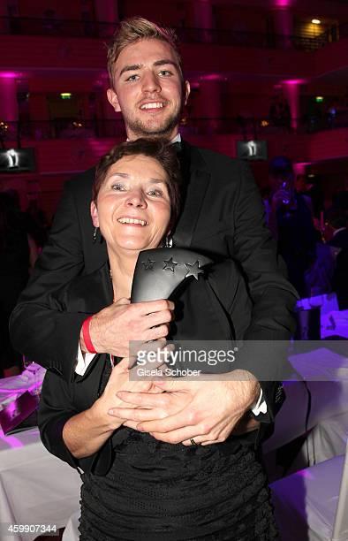 Christoph Kramer and his mother Gabi during the Audi Generation Award 2014 at Hotel Bayerischer Hof on December 3, 2014 in Munich, Germany.