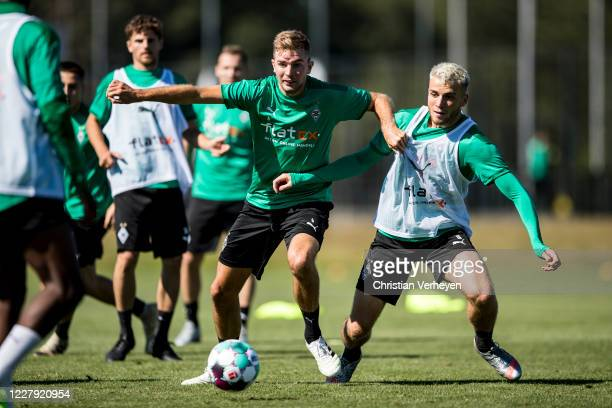 Christoph Kramer and Louis Jordan Beyer in action during a training session of Borussia Moenchengladbach at Borussia-Park on August 05, 2020 in...