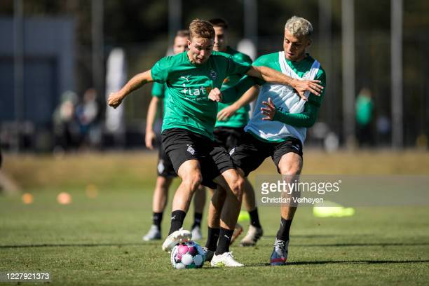 Christoph Kramer and Louis Jordan Beyer in action during a training session of Borussia Moenchengladbach at BorussiaPark on August 05 2020 in...