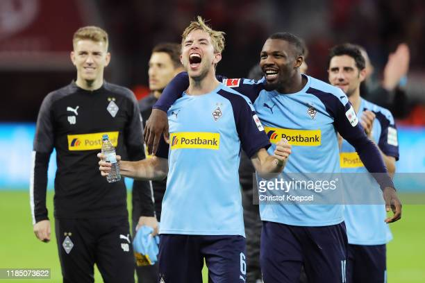 Christoph Kramer and Marcus Thuram of Borussia Monchengladbach celebrate after the Bundesliga match between Bayer 04 Leverkusen and Borussia...