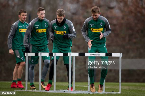 Christoph Kramer and Matthias Ginter of Borussia Moenchengladbach in action during a training session of Borussia Moenchengladbach at BorussiaPark on...