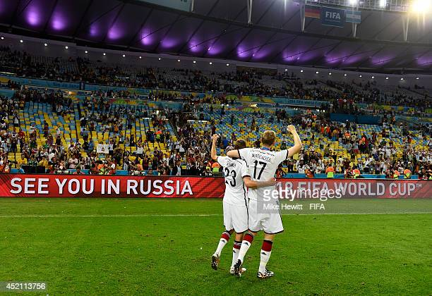 Christoph Kramer and Per Mertesacker of Germany celebrate after the 2014 FIFA World Cup Brazil Final match between Germany and Argentina at Maracana...