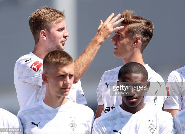 Christoph Kramer checks the hair cut of Florian Neuhaus prior to the team picture in front of the Borussia Park on August 07, 2020 in...