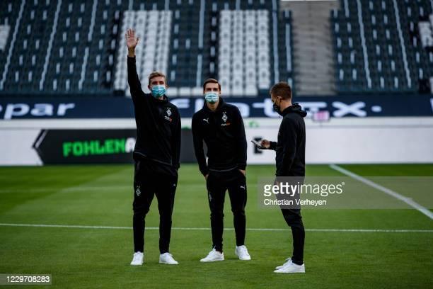 Christoph Kramer Florian Neuhaus and Patrick Herrmann of Borussia Moenchengladbach are seen before the Bundesliga match between Borussia...