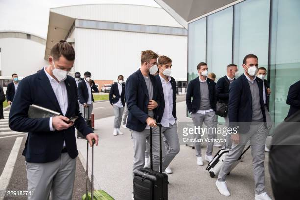 Christoph Kramer Florian Neuhaus and Tobias Sippel are seen during Borussia Moenchengladbach departs to the Group B UEFA Champions League match...