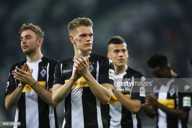 Christoph Kramer Matthias Ginter and Laszlo Benes of Moenchengladbach celebrates with fans after the Bundesliga match between Borussia...