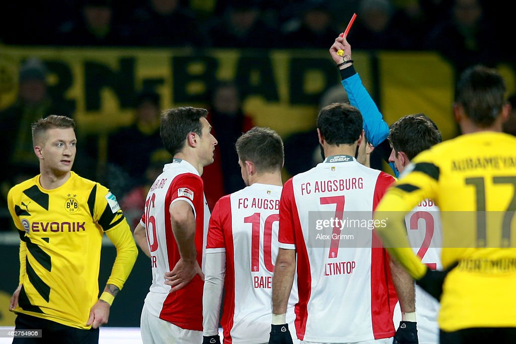 Christoph Kramer (2nd L) of Augsburg receives the Red card from refere Marco Fritz during the Bundesliga match between Borussia Dortmund and FC Augsburg at Signal Iduna Park on February 4, 2015 in Dortmund, Germany.