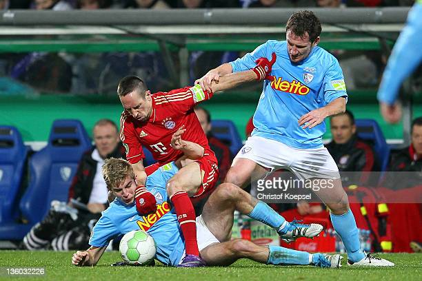 Christoph Kramer of Bochum and Paul Freier of Bochum challenge Franck Ribery of Bayern during the DFB Cup round of sixteen match between VfL Bochum...