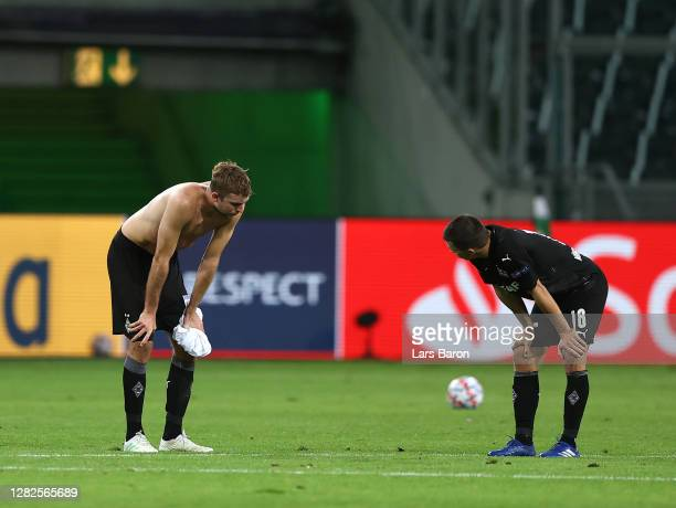 Christoph Kramer of Borussia Moenchengladbacah nd Stefan Lainer of Borussia Moenchengladbach react after the UEFA Champions League Group B stage...