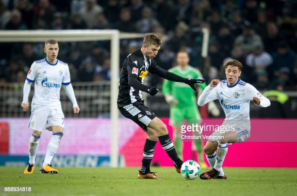 Christoph Kramer of Borussia Moenchengladbach and Amine Harit of FC Schalke 04 battle for the ball during the Bundesliga match between Borussia...