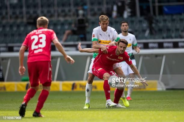 Christoph Kramer of Borussia Moenchengladbach and Christian Gentner of Union Berlin battle for the ball during the Bundesliga match between Borussia...