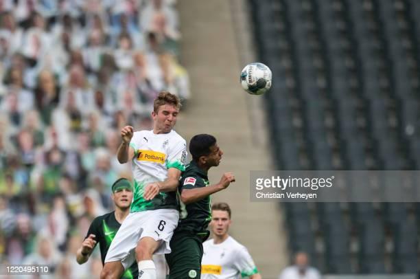 Christoph Kramer of Borussia Moenchengladbach and Joao Victor of VfL Wolfsburg battle for the ball during the Bundesliga match between Borussia...