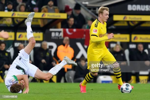 Christoph Kramer of Borussia Moenchengladbach and Julian Brandt of Borussia Dortmund battle for the ball during the Bundesliga match between Borussia...