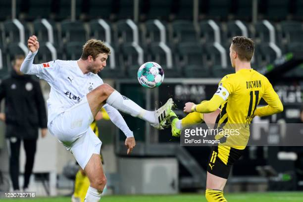 Christoph Kramer of Borussia Moenchengladbach and Marco Reus of Borussia Dortmund battle for the ball during the Bundesliga match between Borussia...