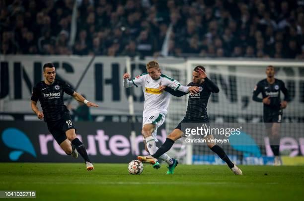 Christoph Kramer of Borussia Moenchengladbach and Mijat Gacinovic of Eintracht Frankfurt battle for the ball during the Bundesliga match between...