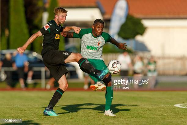 Christoph Kramer of Borussia Moenchengladbach and Sergio Cordova of FC Augsburg battle for the ball during the Friendly match between Borussia...