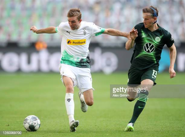Christoph Kramer of Borussia Moenchengladbach battles for possession with Yannick Gerhardt of VfL Wolfsburg during the Bundesliga match between...