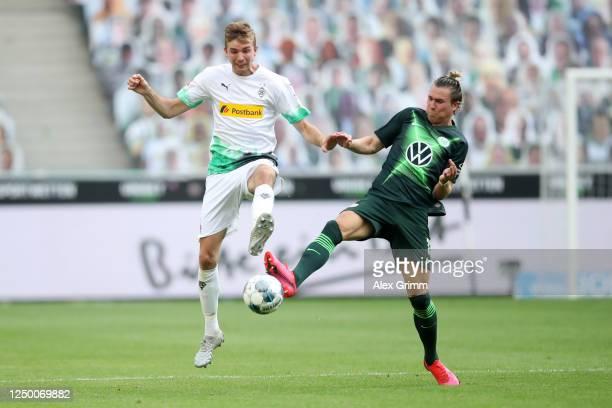 Christoph Kramer of Borussia Moenchengladbach battles for possession with Felix Klaus of VfL Wolfsburg during the Bundesliga match between Borussia...