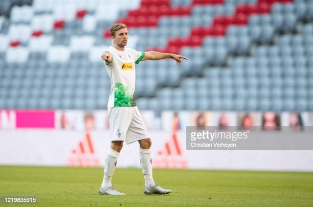 Christoph Kramer of Borussia Moenchengladbach gives instructions during the Bundesliga match between FC Bayern Muenchen and Borussia Moenchengladbach...