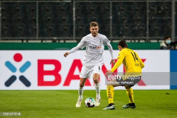 Christoph Kramer of Borussia Moenchengladbach in action during the DFB Cup Quarter Final match between Borussia Moenchengladbach and Borussia...