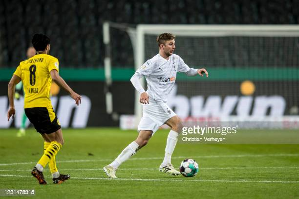 Christoph Kramer of Borussia Moenchengladbach in action during the DFB Cup quarter-final match between Borussia Moenchengladbach and Borussia...