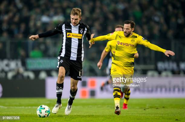 Christoph Kramer of Borussia Moenchengladbach is chased by Gonzalo Castro of Borussia Dortmund during the Bundesliga match between Borussia...