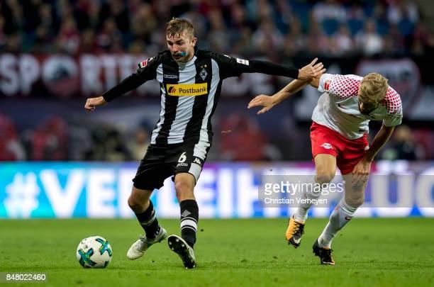 Christoph Kramer of Borussia Moenchengladbach is chased by Konrad Laimer of RB Leipzigduring the Bundesliga match between RB Leipzig and Borussia...