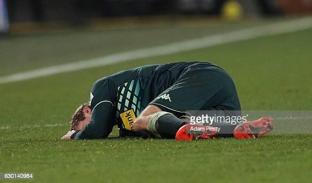 Christoph Kramer of Borussia Moenchengladbach is injured during the Bundesliga match between FC Augsburg and Borussia Moenchengladbach at WWK Arena...