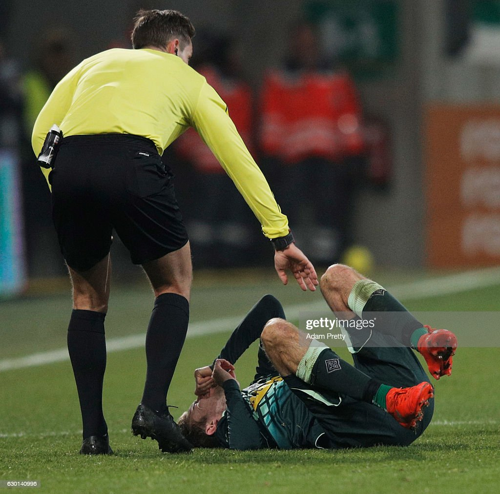 Christoph Kramer of Borussia Moenchengladbach is injured during the Bundesliga match between FC Augsburg and Borussia Moenchengladbach at WWK Arena on December 17, 2016 in Augsburg, Germany.