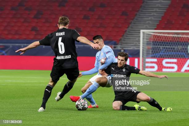 Christoph Kramer of Borussia Moenchengladbach, Joao Cancelo of Manchester City and Jonas Hofmann of Borussia Moenchengladbach battle for the ball...